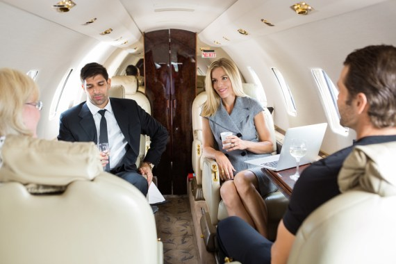 People sitting comfortably on a private jet.