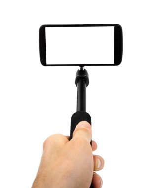 A hand holds a smartphone attached to a selfie stick.