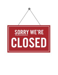 """An image of a red sign that reads, """"Sorry, we're closed."""""""