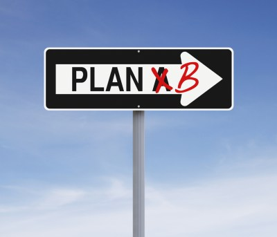 """A photo of a one-way sign that reads """"Plan A"""" except """"A"""" is crossed out and in its place is """"B."""""""