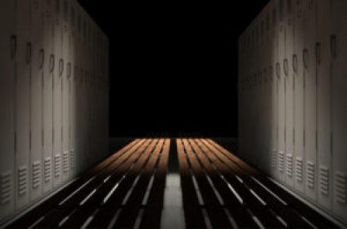 A photo of a dimly lit locker room.