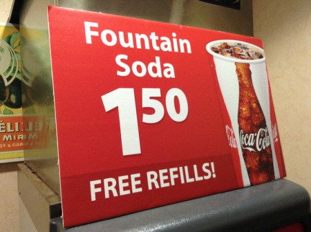 "A sign that reads, ""Fountain soda $1.50. Free refills!"""