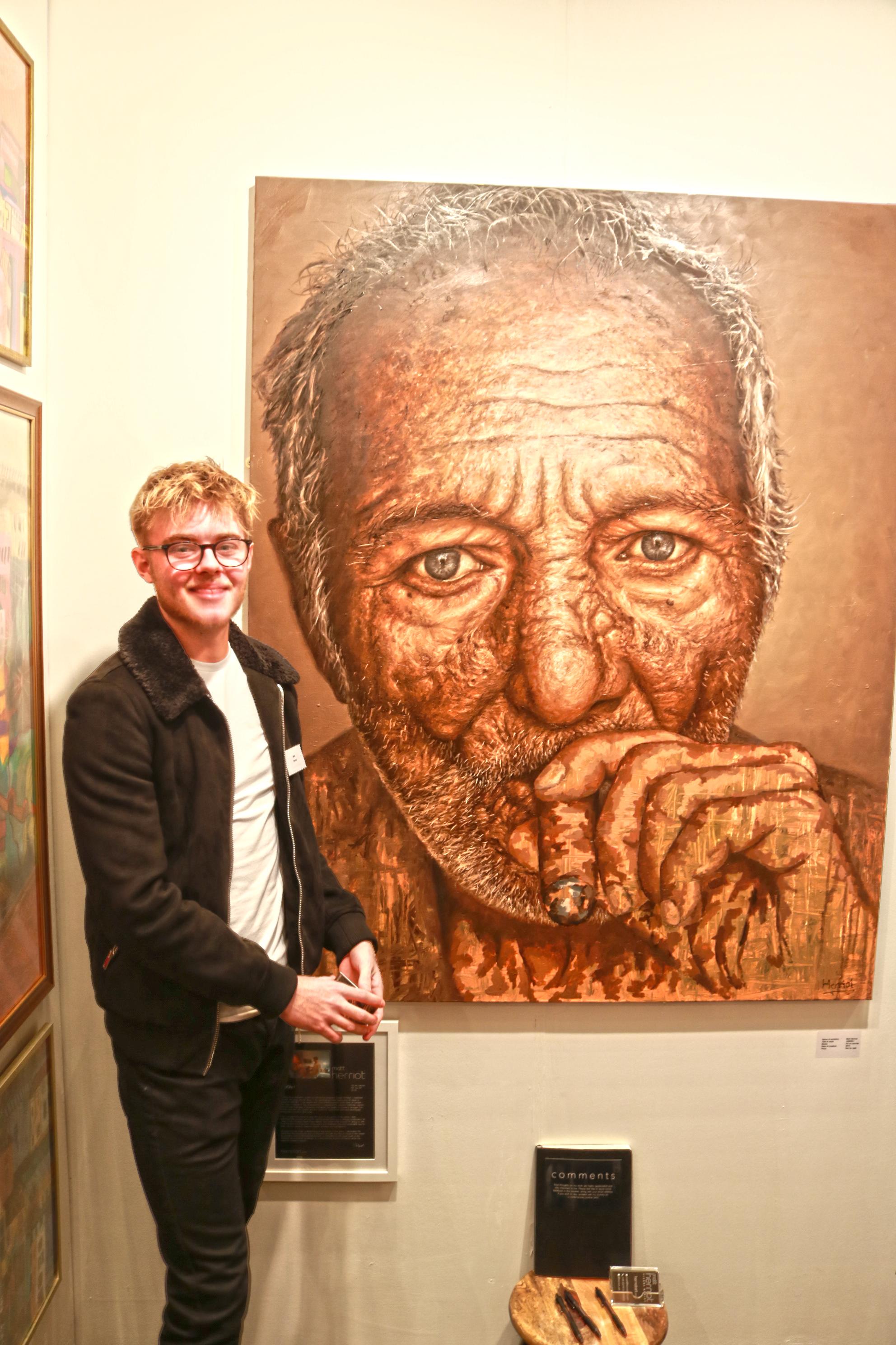Matt Herriot and his painting at the Parallax art fair in London