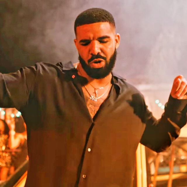 Canadian rapper Drake dancing in the MIA music video alongside bad bunny
