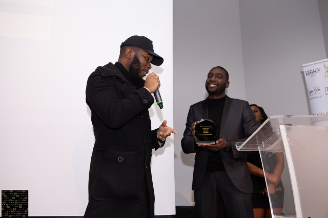 Shadez the Misfit presenting Kaniva with his award