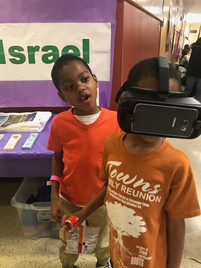 JJ taking a virtual reality tour of Jerusalem.