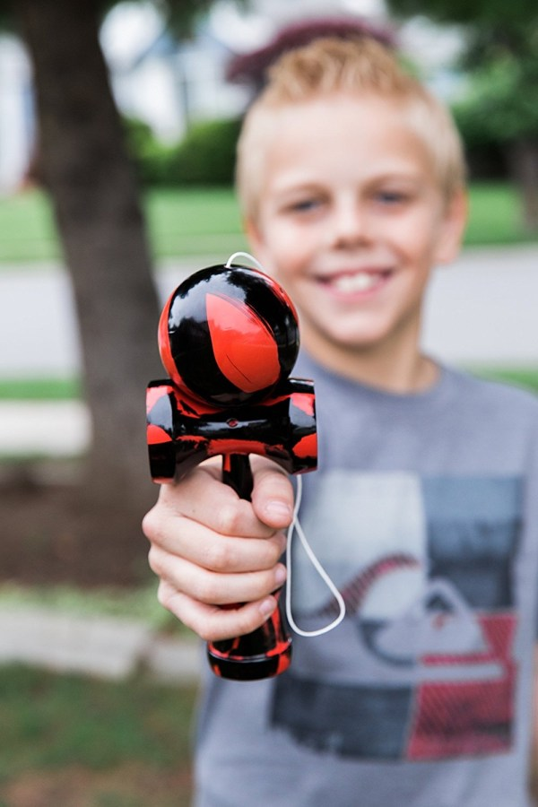 Kendama Kraze Wood Toy Red & Black Kendama Kraze Wood Toy - Extra String- Tribute Samurai Red & Black Pro Model; EXTRA STRING INCLUDED- Each Kendama Kraze is Packaged with Extra String for Longer Play Value and More Fun with Your Friends.