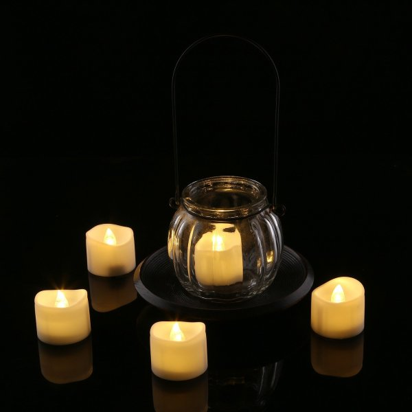 Homemory Electric Fake Candle Homemory Realistic and Bright Flickering Bulb Battery Operated Flameless LED Tea Light for Seasonal & Festival Celebration, Pack of 12, Electric Fake Candle in Warm White and Wave Open.