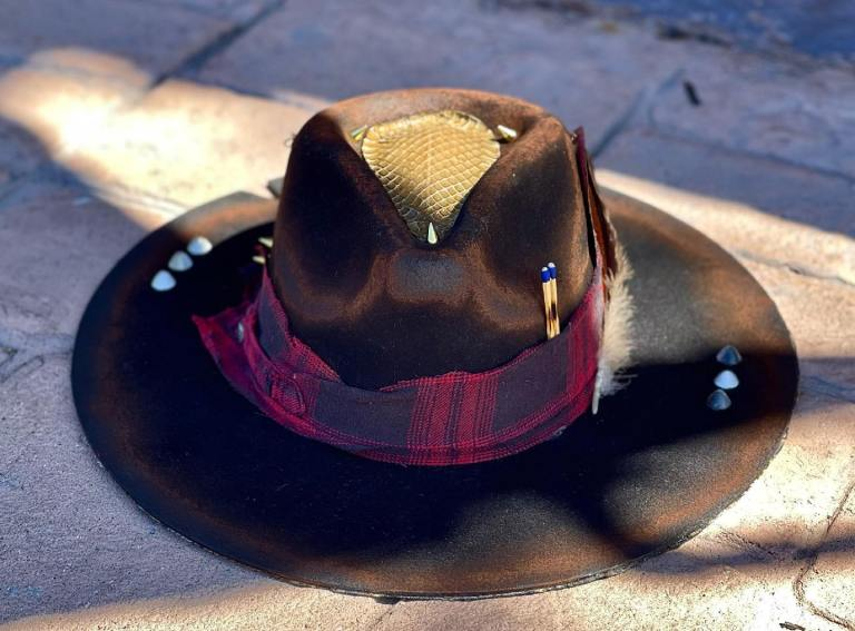 Black custom hat with red plaid decor, studs and chains