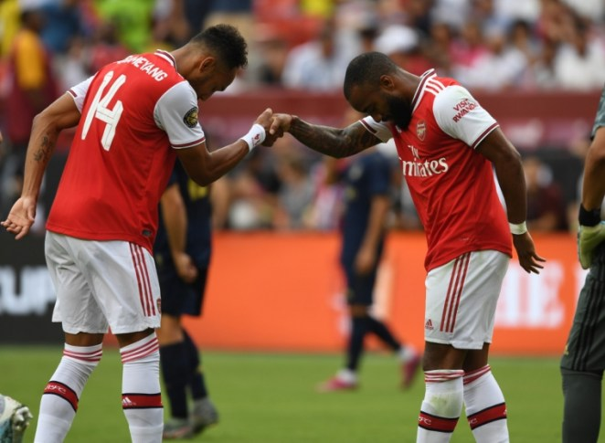 Pierre-Emerick Aubameyang celebrates scoring the 2nd Arsenal goal with Alexandre Lacazette during the International Champions Cup match against Real Madrid on 23 July 2019 (Arsenal FC via Getty Images)