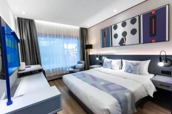 輕住集團新品牌樣板間首次揭面紗 亮相上海酒店投資展引領投資熱潮_騰訊新聞