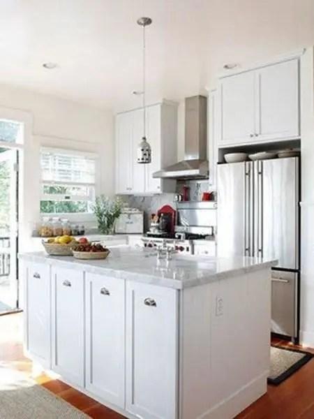 kitchen island with range distressed black cabinets 有了11招扩容方法何必花大钱 厨房内的物品多而杂乱 设计一个收纳功能完善的小户型厨房空间更是非常棘手 设计者利用实用岛台围合出相对独立的空间范围 有效地分割了功能区