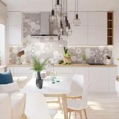 Kitchen Table Set With Bench Kohler Cast Iron Sink 室内设计 如何用白色和原木色打造明亮空间 总统家文章 白色的沙发位于最长的墙的中间 上面摆放着一个醒目的几何印花垫子和一个蓝色的图案垫子 由于餐桌的一侧被推到与之齐平的位置上 这张沙发又兼作长椅式的座位