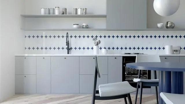 grey kitchen backsplash island range 室内设计 夏季色彩装饰和室内分区技术 天天快报 蓝色和白色的瓷砖创造了一个诱人的后挡板 黑色的水龙头和黑色的橱柜把手装饰着厨房