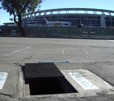 A grate inlet was tested in the Qualcomm Stadium parking lot. Photo: City of San Diego Storm Drain Inlet Pilot Study report.
