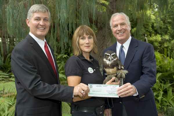Supervisor Dave Roberts presents San Diego Zoo Global Chairman Rick Gulley with a $7,000 county grant. A proposed amendment would limit supervisors to using these regular-sized checks during public presentations. July 25, 2014. Photo by Tammy Spratt, San Diego Zoo Global