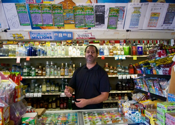 Mike Zeidan has managed King's Liquor in Paradise Hills for 20 years, selling lottery tickets the whole time. Credit: Leo Castaneda/inewsource