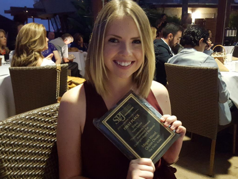 Megan Wood, inewsource photography intern, shows off her award at the 2015 San Diego SPJ Awards.