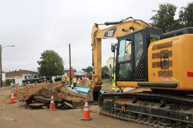 A crew from TC Construction works on replacing cast iron pipes on 60th Street south of El Cajon Boulevard on Oct. 16, 2015. Megan Wood, inewsource.