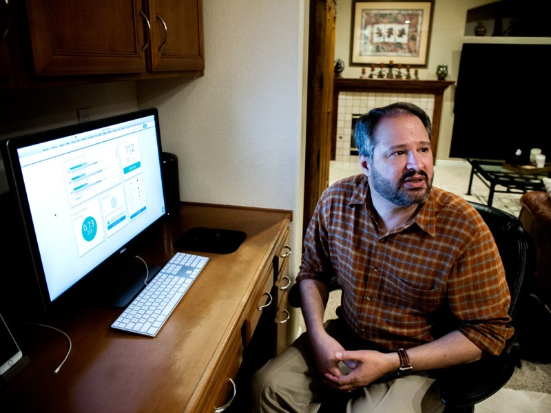 Torrey Hills resident Steve Reed uses OhmConnect, a service that pays customers to lower their energy use at home during periods of high demand. Reed says the company has paid him about $100 a year. Feb. 8, 2017. Megan Wood, inewsource.