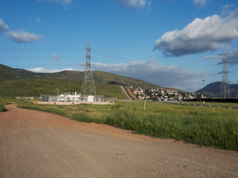 Sempra natural gas pipeline crossing at the border near Otay Mesa, California. Homes in the background are in Mexico. March 23, 2017. Megan Wood, inewsource.