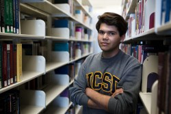 Felipe Morfin Martinez, a former student at Gompers Preparatory Academy, is a communications pre-major at UCSD. He posed for a portrait on May 17, 2017 inside of the Biomedical Library. Megan Wood, inewsource.