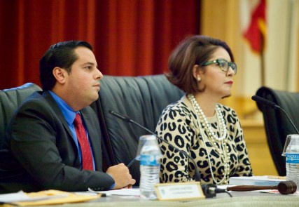 San Ysidro school board President Rosaleah Pallasigue and board member Antonio Martinez listen to public comment during an October school board meeting. The district is facing an extraordinary audit following concerns of potential financial misdeeds.(Leonardo Castañeda/inewsource)