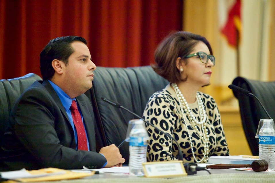 San Ysidro School District Board President Rosaleah Pallasigue and Board Member Antonio Martinez listen to public comment during a recent school board meeting. Oct. 12, 2017. Leonardo Castañeda, inewsource