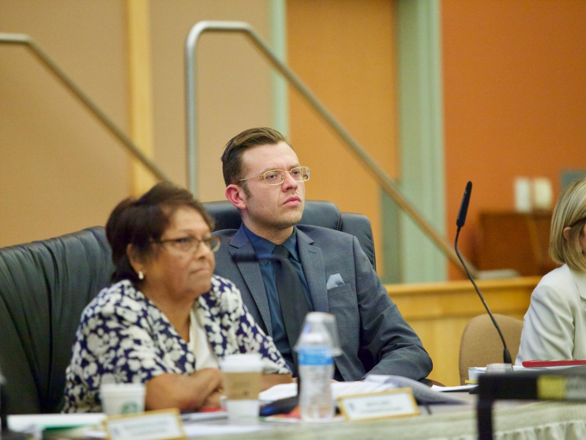 San Ysidro School District's formerm interim superintendent, Jose Arturo Sanchez-Macias, listens to public comments during an October school board meeting. (Leonardo Castañeda/inewsource)