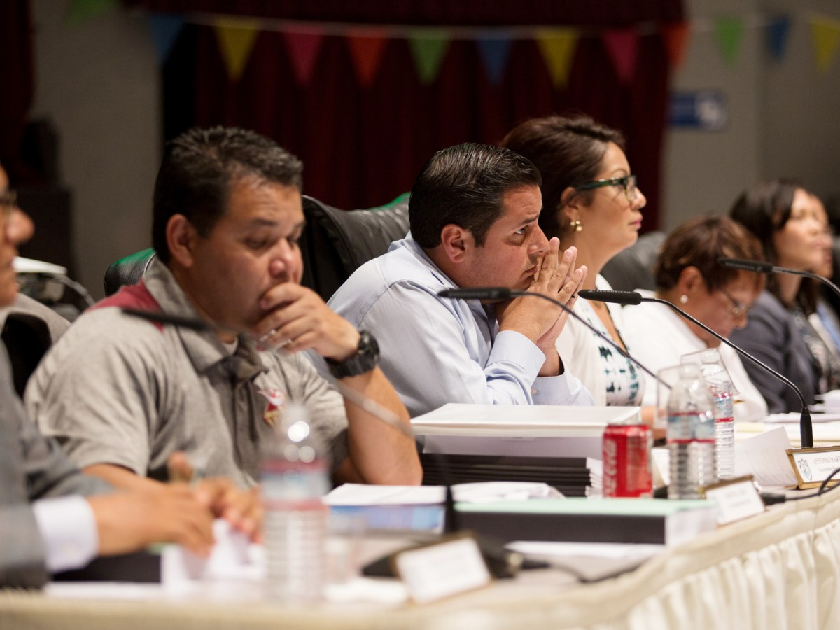 San Ysidro school board members listen to a presentation on June 14, 2018, by Paul Gothold, the San Diego County schools superintendent, as he discusses the findings of a state audit that found possible financial fraud and misuse of district funds. (Megan Wood/inewsource)