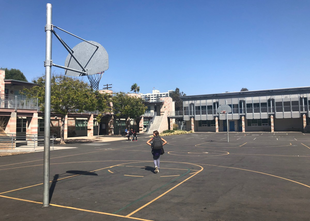 Students walk across the basketball courts at Grant Elementary School in the San Diego Unified School District on Sept. 20, 2018.