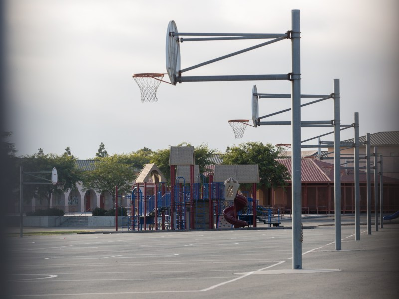 An empty playground is shown through a fence at Ocean View Hills Elementary in San Ysidro on Sept. 24, 2018. (Megan Wood/inewsource)