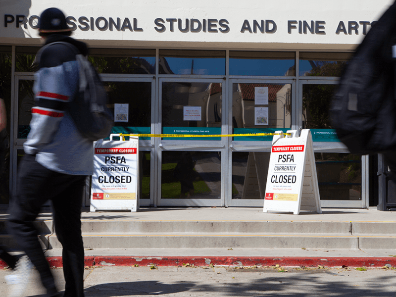 Students pass the College of Professional Studies and Fine Arts building at San Diego State University on March 28, 2019. The building was closed from odors because of roofing repairs.