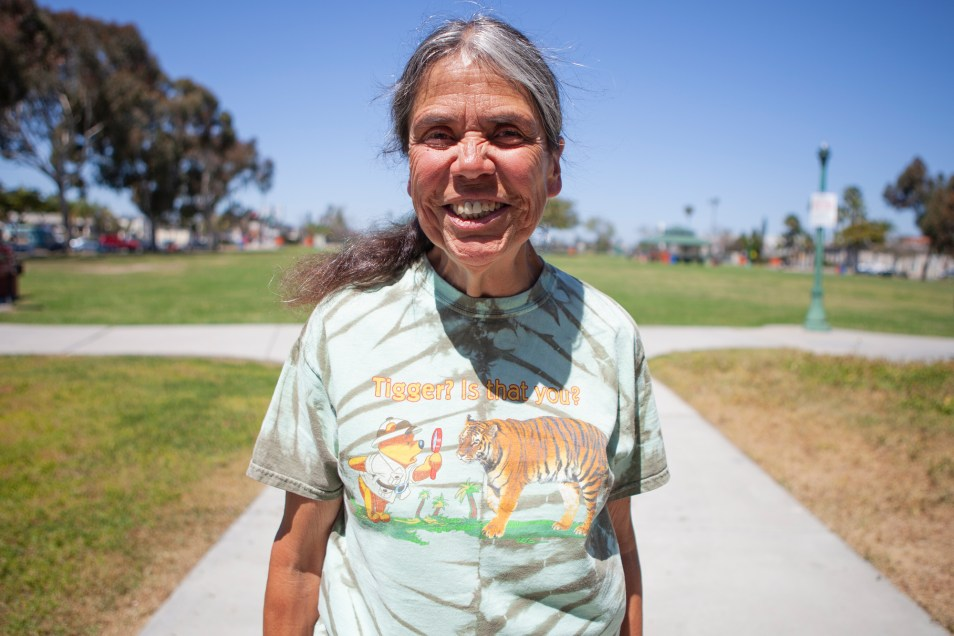 Mass transit user Maria Cortez, who only uses buses and trolleys for transportation, is shown in City Heights on April 17, 2019. (Brandon Quester/inewsource)