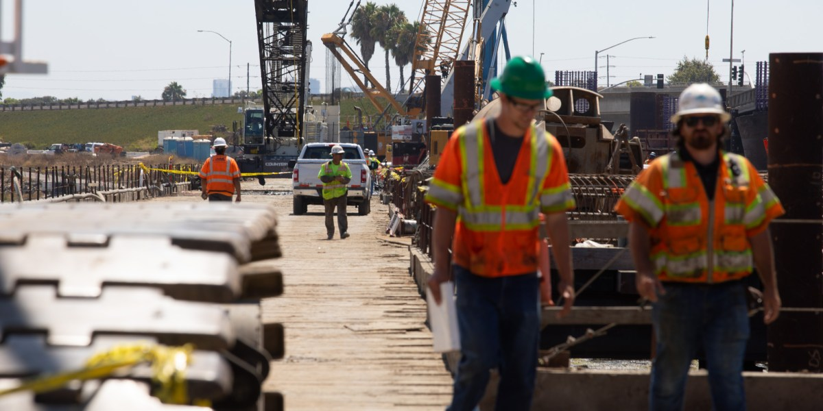 Construction crews work on the West Mission Bay Drive bridge.