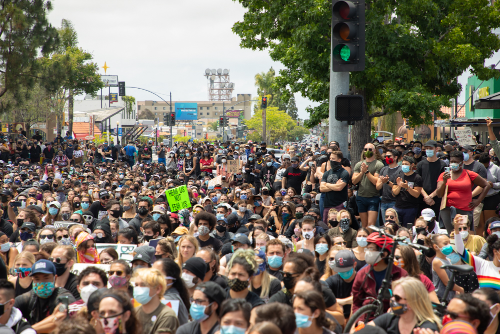 Thousands gather in Hillcrest near the Pride Flag after marching from the Waterfront Park by San Diego Bay to protest the police killing of George Floyd.