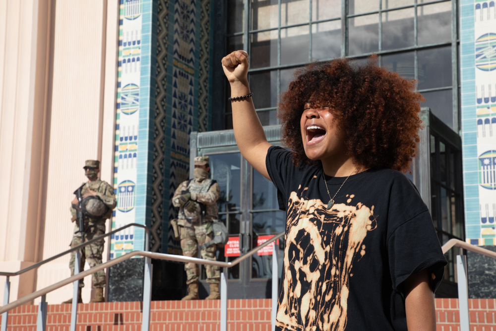 Tyhara Tyrell leads chants with demonstrators for several minutes outside the San Diego County Administration Building to protest the killing of George Floyd and other black men and women by police, June 6, 2020.
