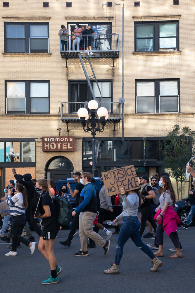 A protest over the killing of George Floyd and other black men and women by police marches through San Diego's Gaslamp Quarter, June 6, 2020.