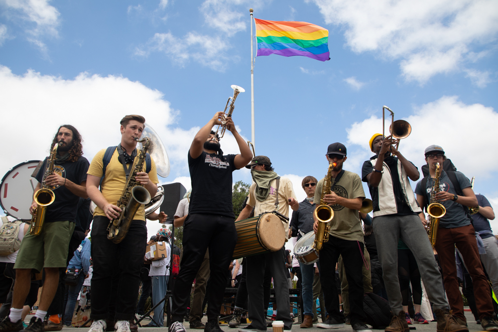 A band plays under the Hillcrest Pride Flag after thousands of protesters marched there from the Waterfront Park on San Diego Bay, June 6, 2020. The group later returned to the park.