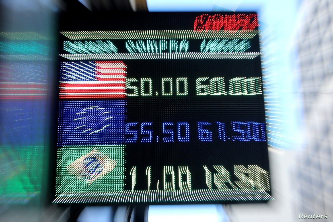 An electronic board shows currency exchange rates in Buenos Aires' financial district, Argentina, Aug. 12, 2019.