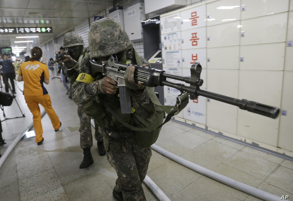 South Korean army soldiers aim their weapons during an anti-terror drill as part of Ulchi Freedom Guardian exercise, at Sadang Subway Station in Seoul, South Korea, Wednesday, Aug. 19, 2015.