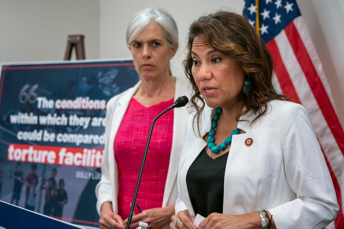 Rep. Veronica Escobar, D-Texas, joined at left by Rep. Katherine Clark, D-Mass., vice chair of the Democratic Caucus, speaks with reporters following a meeting of fellow Democrats focusing on a path to emergency humanitarian aid to help migrants…