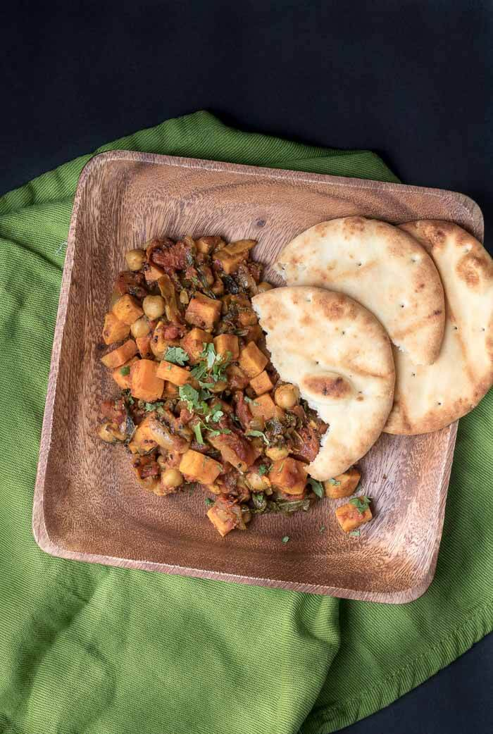 Sweet Potato and Chickpea Curry swiss chard sweet potato spices Naan bread curry cilantro chickpeas black mustard seeds