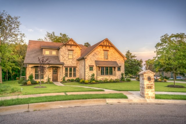 large brick home with nice front yard for a great first impression.