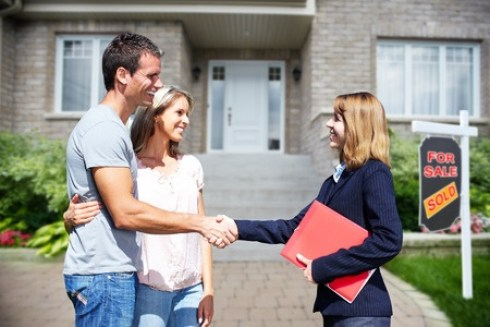 A Realtor thanking the home seller for payment after selling theor home.
