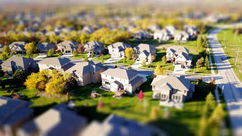 neighborhood of residential homes depicting the housing inventory crisis