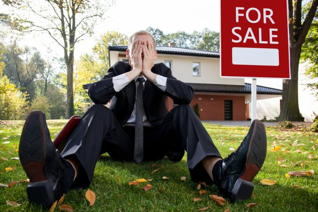 A sad real estate agent knowing they could become obsolete