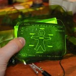 "A little ""Pip-Boy"" graphic is sandwiched between the plexiglass and an ordinary green gel."