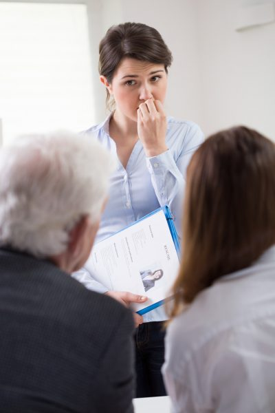 Young female worried candidate on job meeting