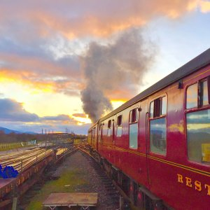 Old Strathspey steam train travelling towards sunset, Cairngorms National Park, Scotland